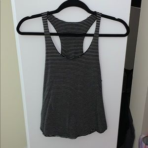 One grey and one black stripped tank tops.